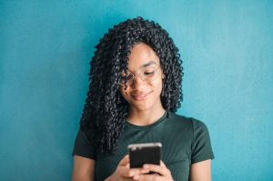 girl texting and smiling