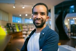 Man smiling in library